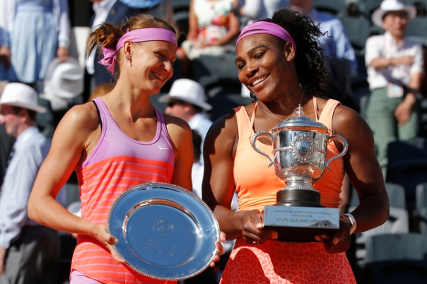 Serena Williams of the U.S., right, holds the trophy after winning the final of the French Open tennis tournament against Lucie Safarova of the Czech Republic, left, in three sets, 6-3, 6-7, 6-2, at the Roland Garros stadium, in Paris, France, Saturday, June 6, 2015. (AP Photo/Michel Euler)